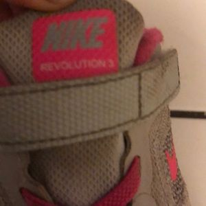 White & pink Nike revolution 3 running shoes